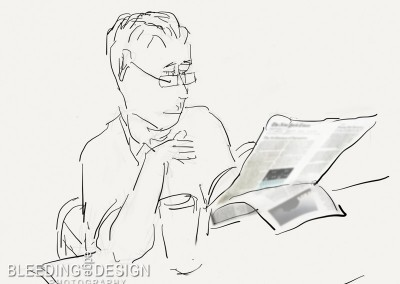 guy reading paper