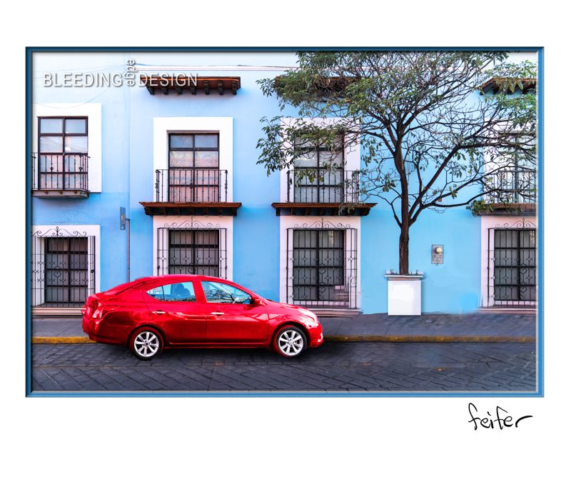 Red Car on a Blue Street